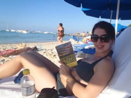 The Academic Wino enjoying Reading between the Wines on a sunny beach in Mexico!