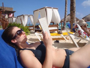 "The Academic Wino enjoying a book (""Reading Between the Vines"") on a beach in sunny Mexico! Image Copyright RYeamans 2013"